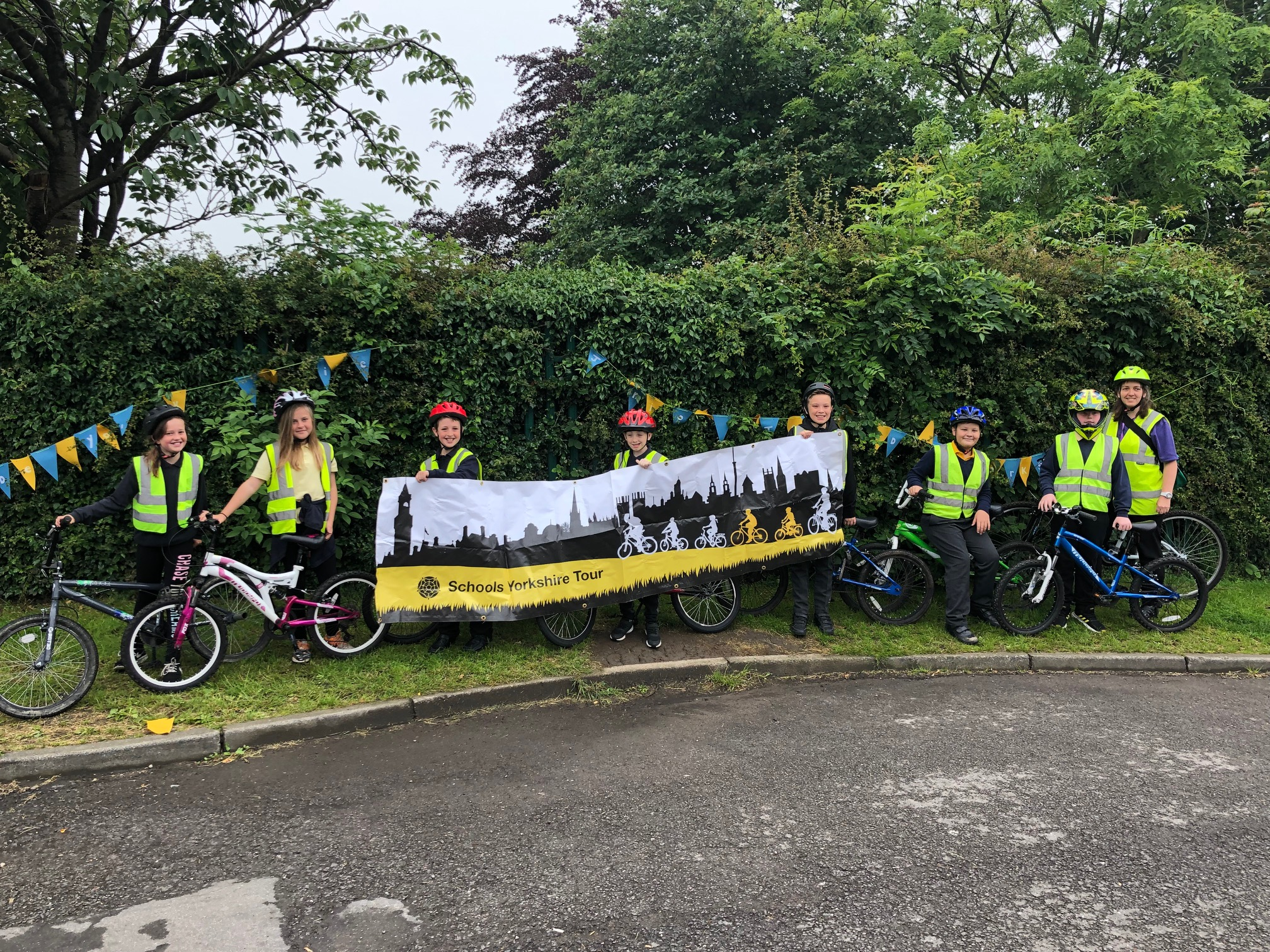 Schools Yorkshire tour - bikers holding sign