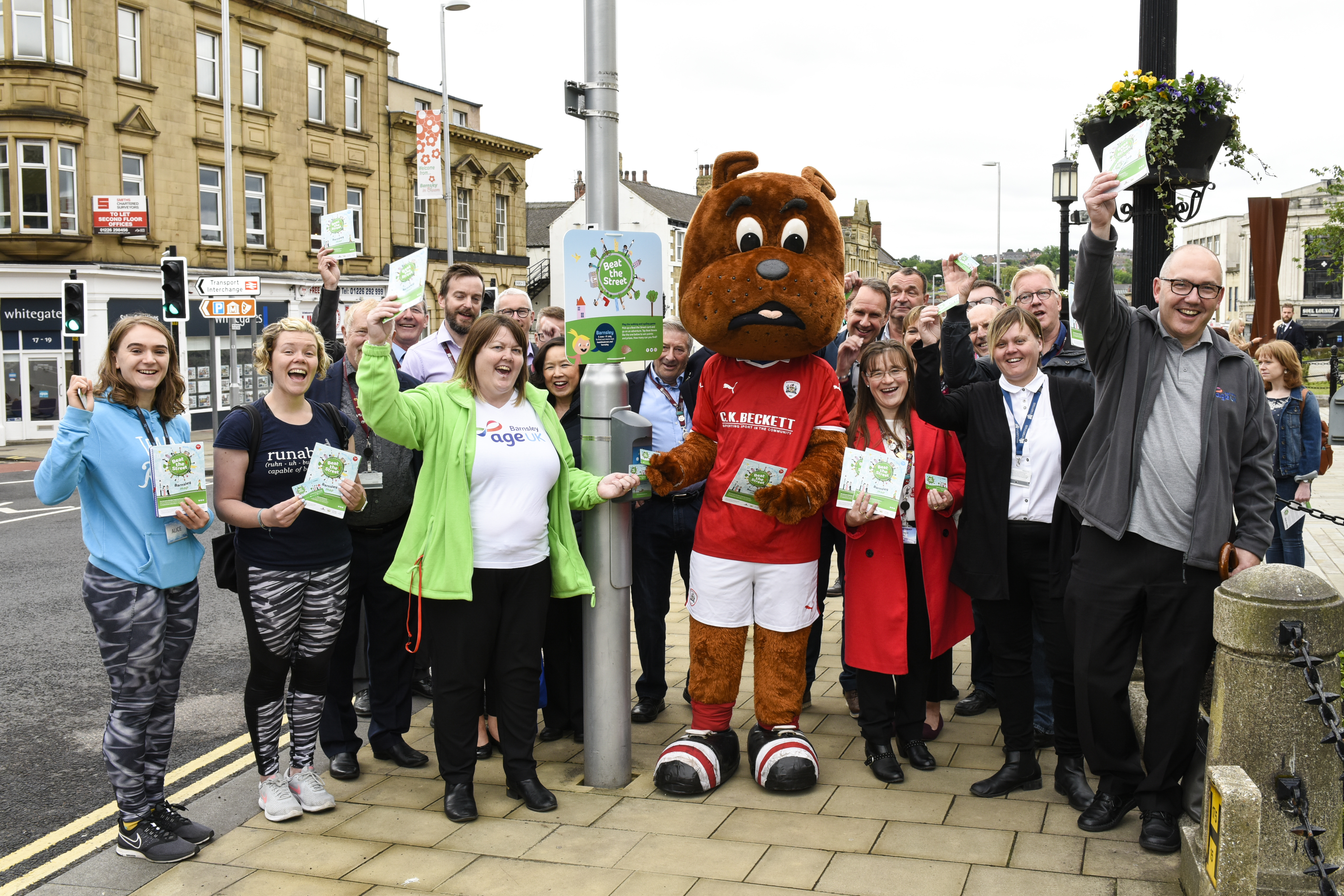 People with the Barnsley football club mascot - Toby Tyke in Barnsley Town centre