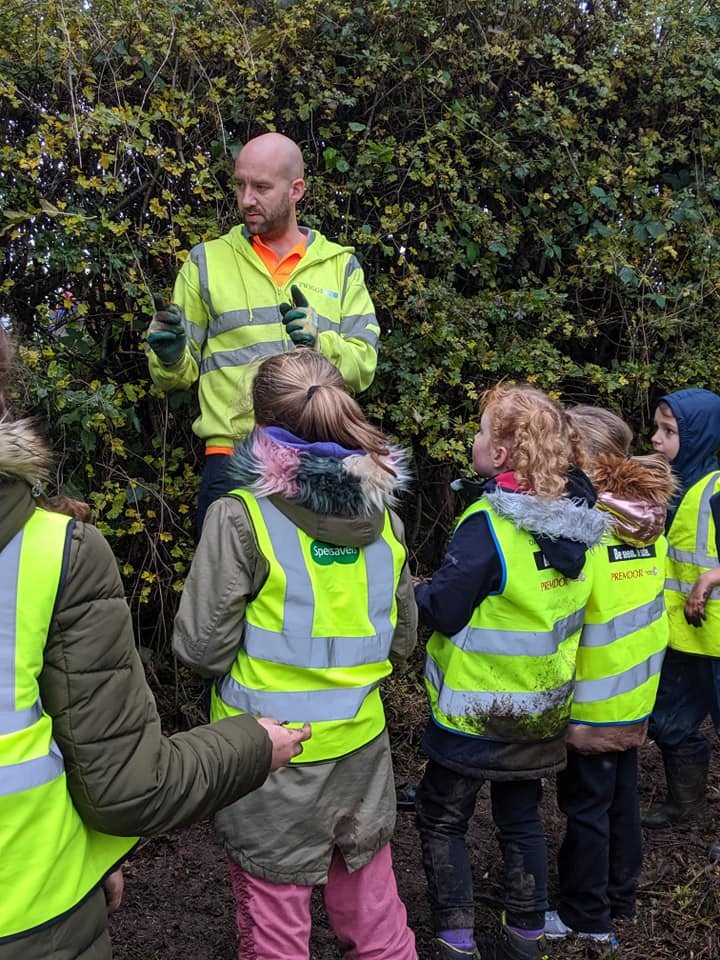 Twiggs telling Darton School children how to plant the fruit trees.jpg