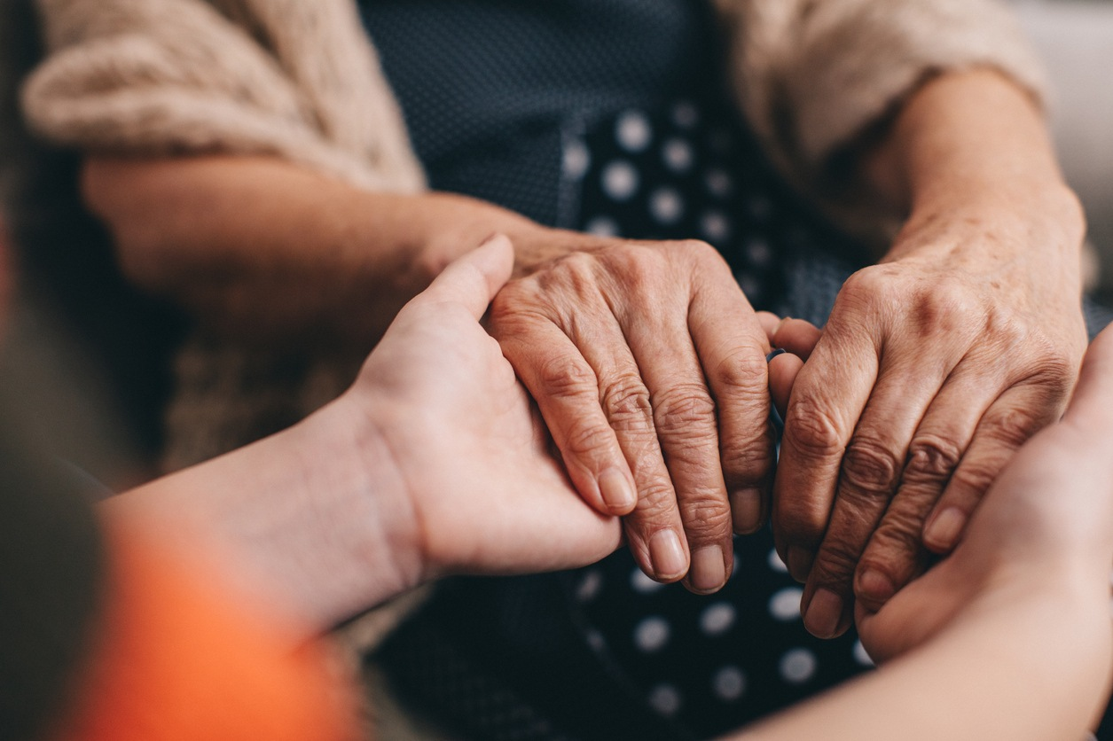 safeguarding adults -  two people holding hands