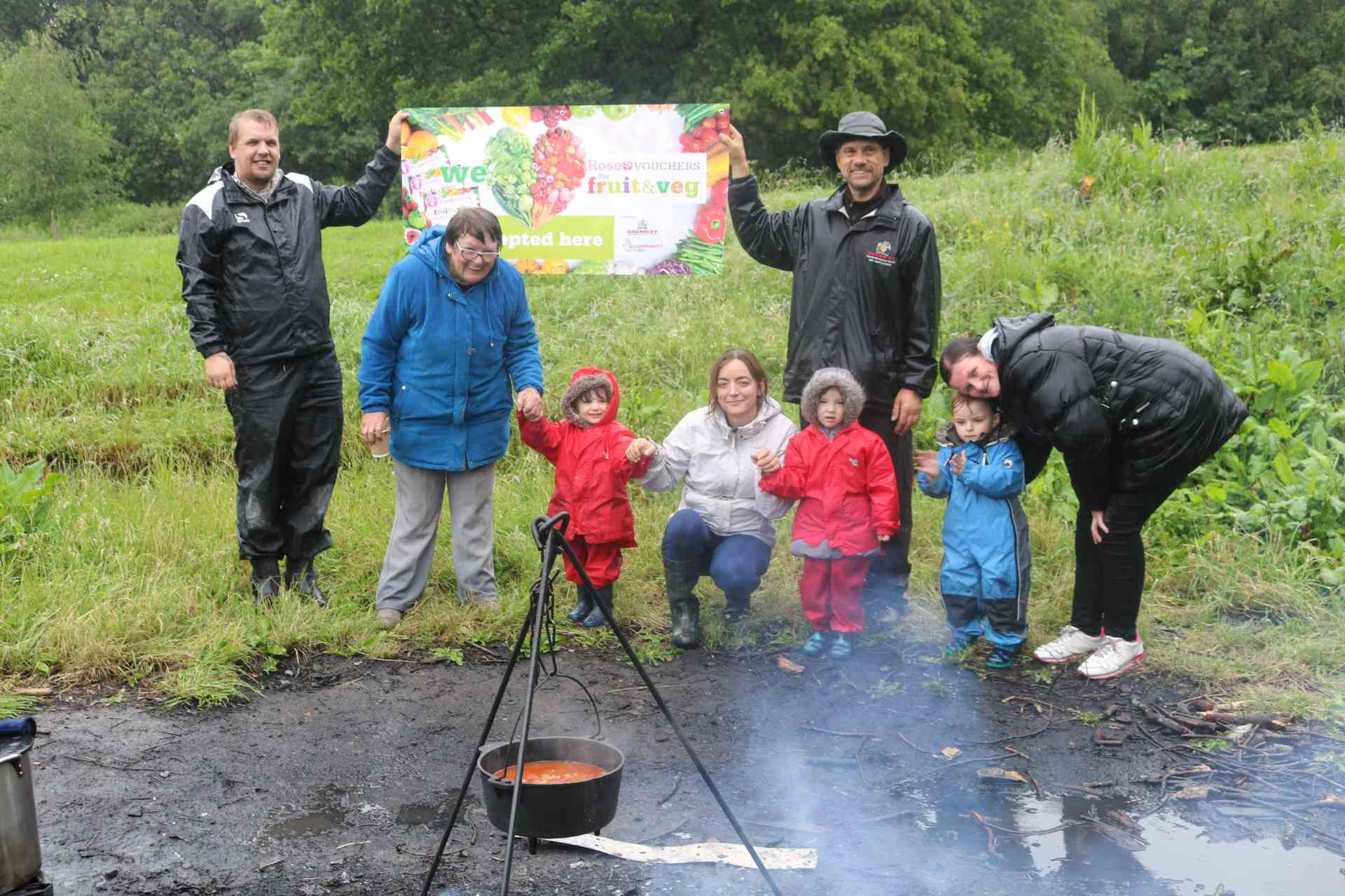 Rose voucher celebration photo - people cooking in the wild