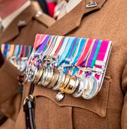 Ex serviceman wearing badges