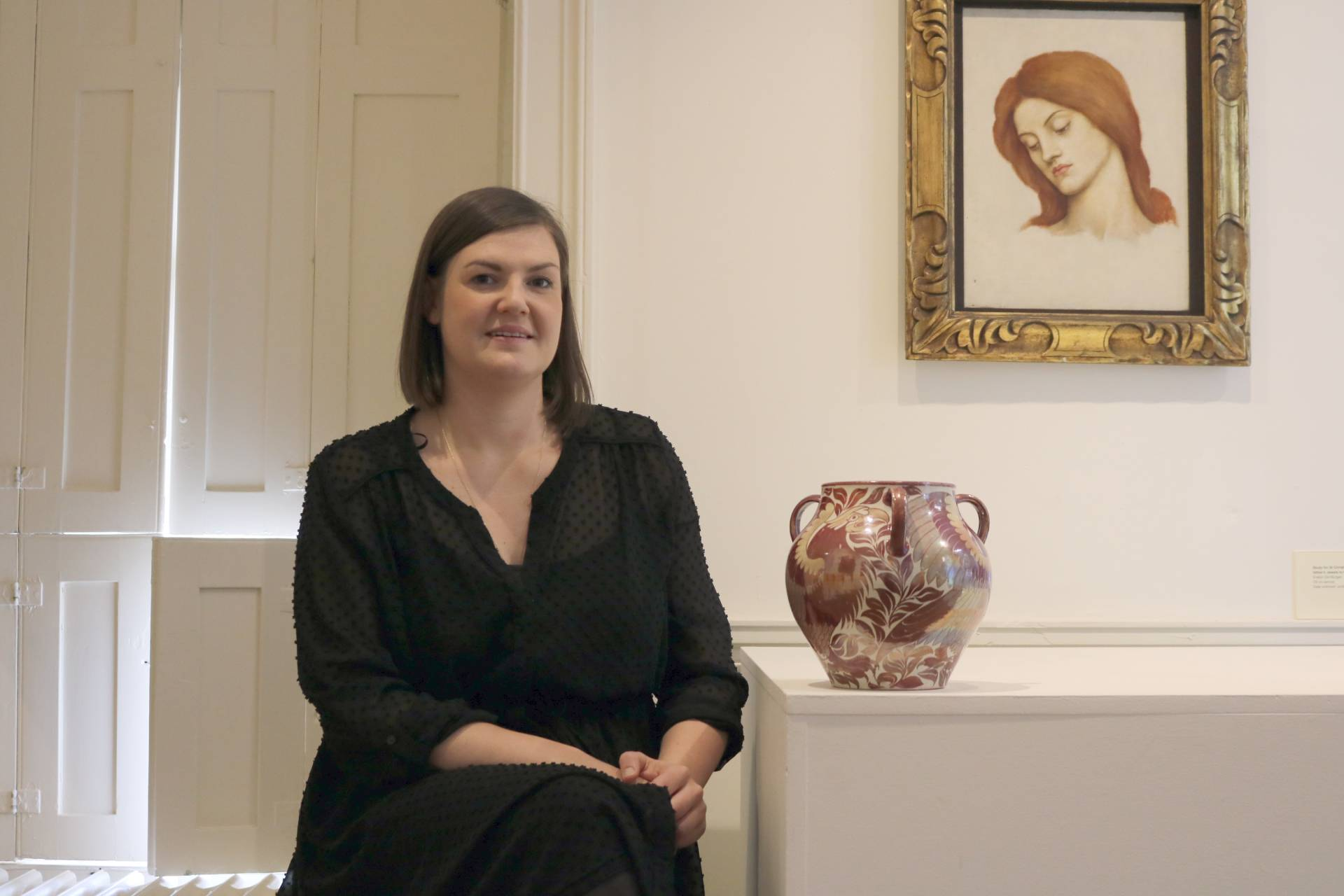 Sarah Hardy stood with the William De Morgan vase at Cannon Hall