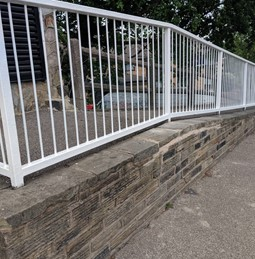 Stairfoot wall and railing repairs