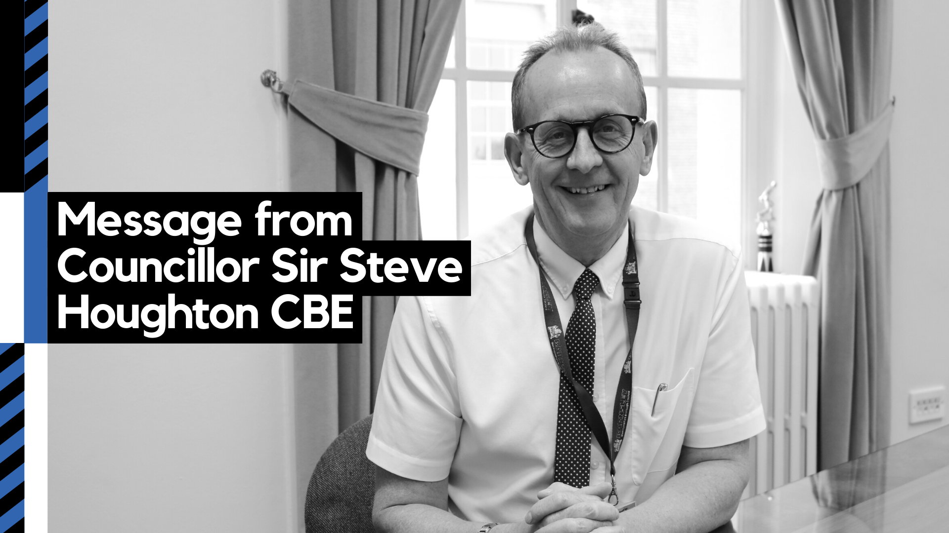Photo of Councillor Sir Steve Houghton CBE sat at his desk