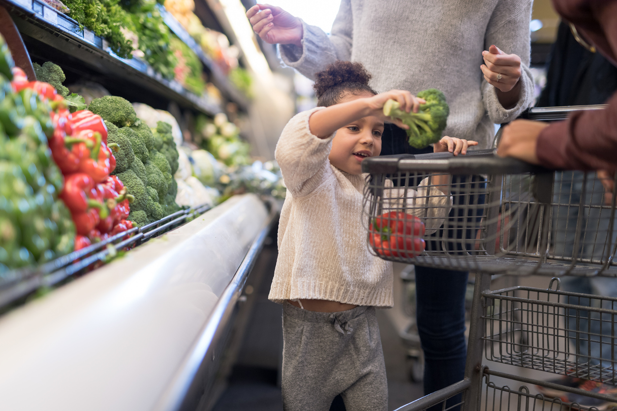 Child food shopping with parents
