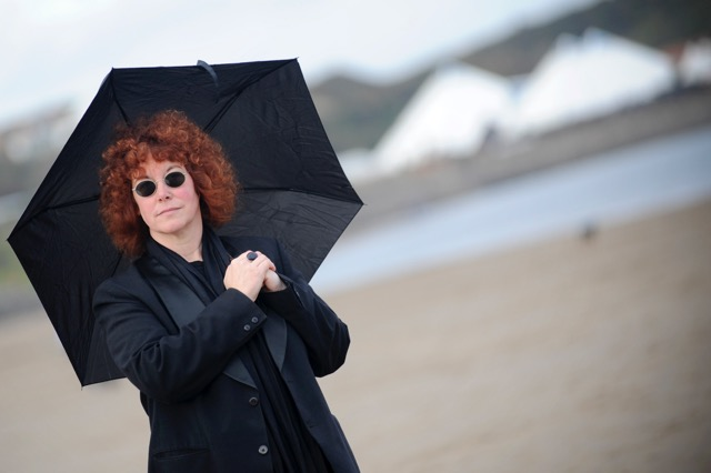 Woman wearing black with black umbrella