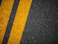 Close up of a road with double yellow lines